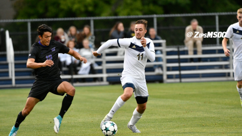 Sophomore, Marcel Zajac defending the ball against UC-Santa Barbara, 3-1. (Photo courtesy of Zips Men's Soccer)