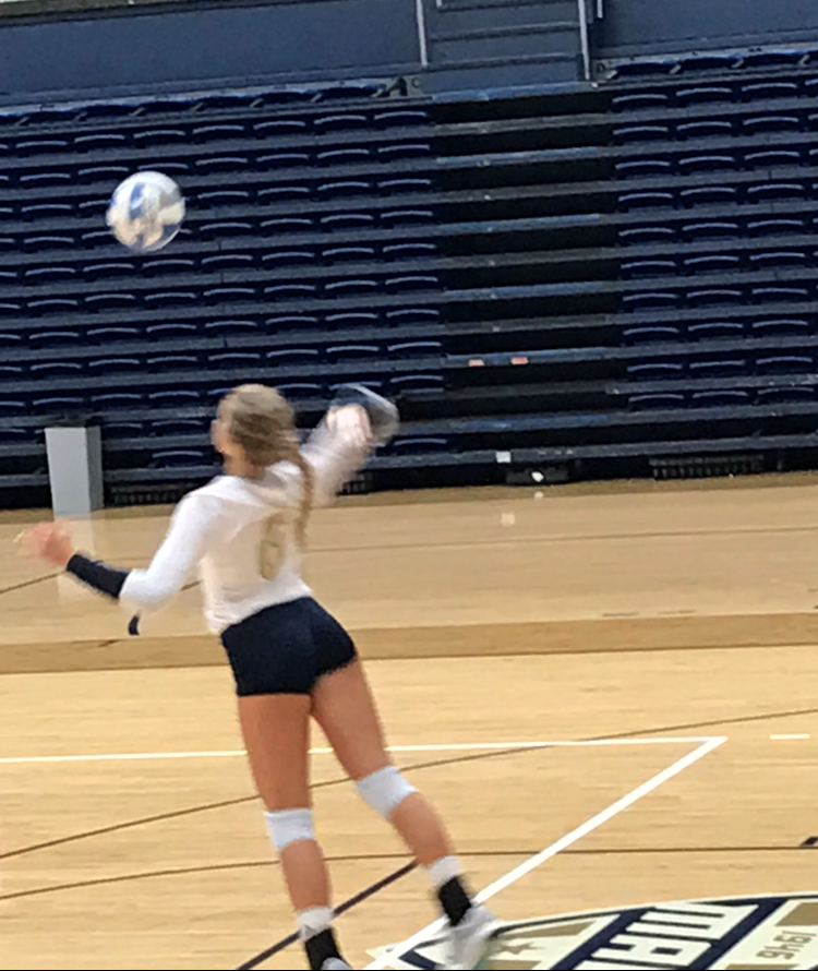 Left side hitter Kayla Gwozdz serving for the Zips this weekend against Kent State.