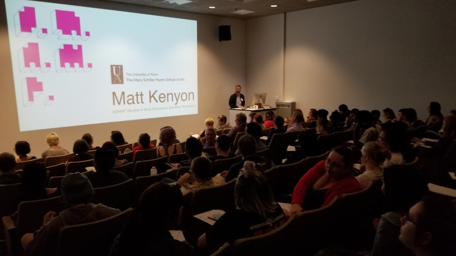 Artist Matt Kenyon presents a lecture in Folk Hall at The University of Akron,.