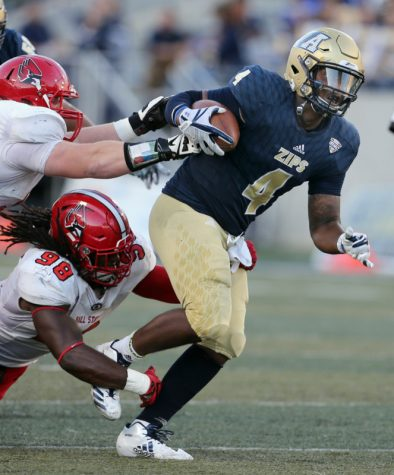 Zips QB Thomas Woodson tries to outrun Ball State's John Swisher and Anthony Winbush during Saturday's game. (Photo courtesy of Zips Football)