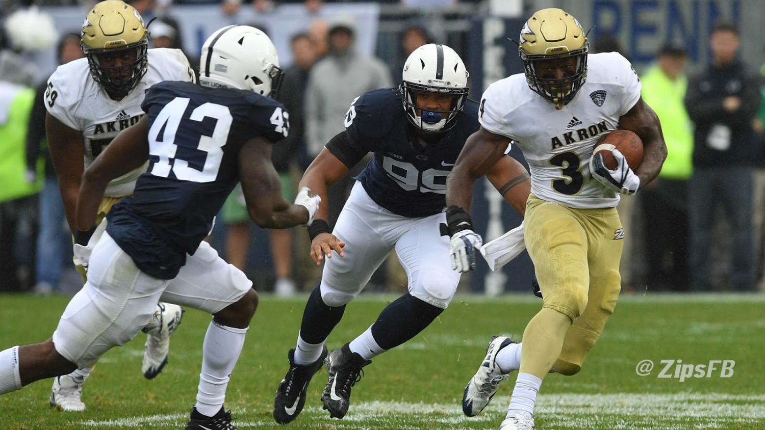 RB Warren Ball charges through the Nittany Lion Defensive Line. (Photo courtesy of Zips Football)