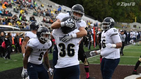 Members of the Akron Football team celebrate during their game in Kalamazoo, MI Sunday. (Photo courtesy of Akron Athletics)