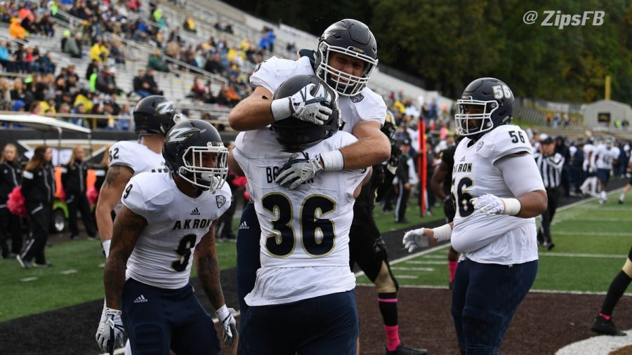 Members+of+the+Akron+Football+team+celebrate+during+their+game+in+Kalamazoo%2C+MI+Sunday.+%28Photo+courtesy+of+Akron+Athletics%29