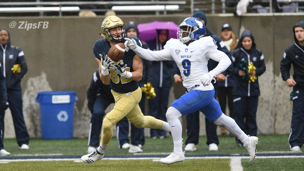 Akron receiver Austin Wolf catches a pass just out of the reach of a Buffalo defender during Saturday's win. (Photo courtesy of Zips Football)