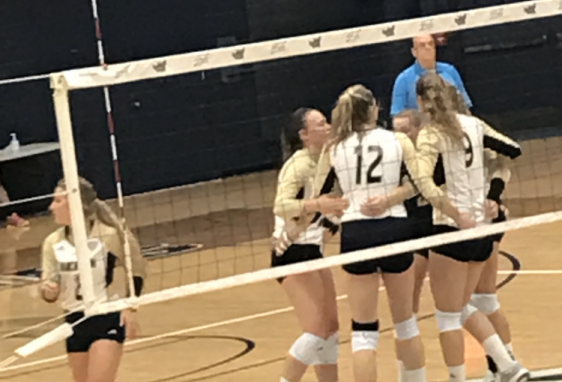 The Zips huddle following a point during a home match against Ohio.