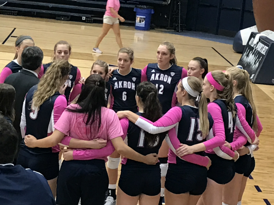 The+Zips+Volleyball+team+huddles+prior+to+the+start+of+their+match+against+Northern+Illinois+on+Saturday+Oct.+14.