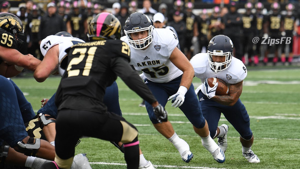 Akron's Brandon Junk moves to block for Manny Morgan during their win over Western Michigan. (Photo courtesy of Akron Athletics)