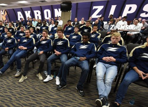 The Akron Men's Soccer team gathers at the James A. Rhodes Arena for the NCAA Men's Soccer Championship Selection Show with students and faculty. Photo Courtesy of The University of Akron Department of Athletics)