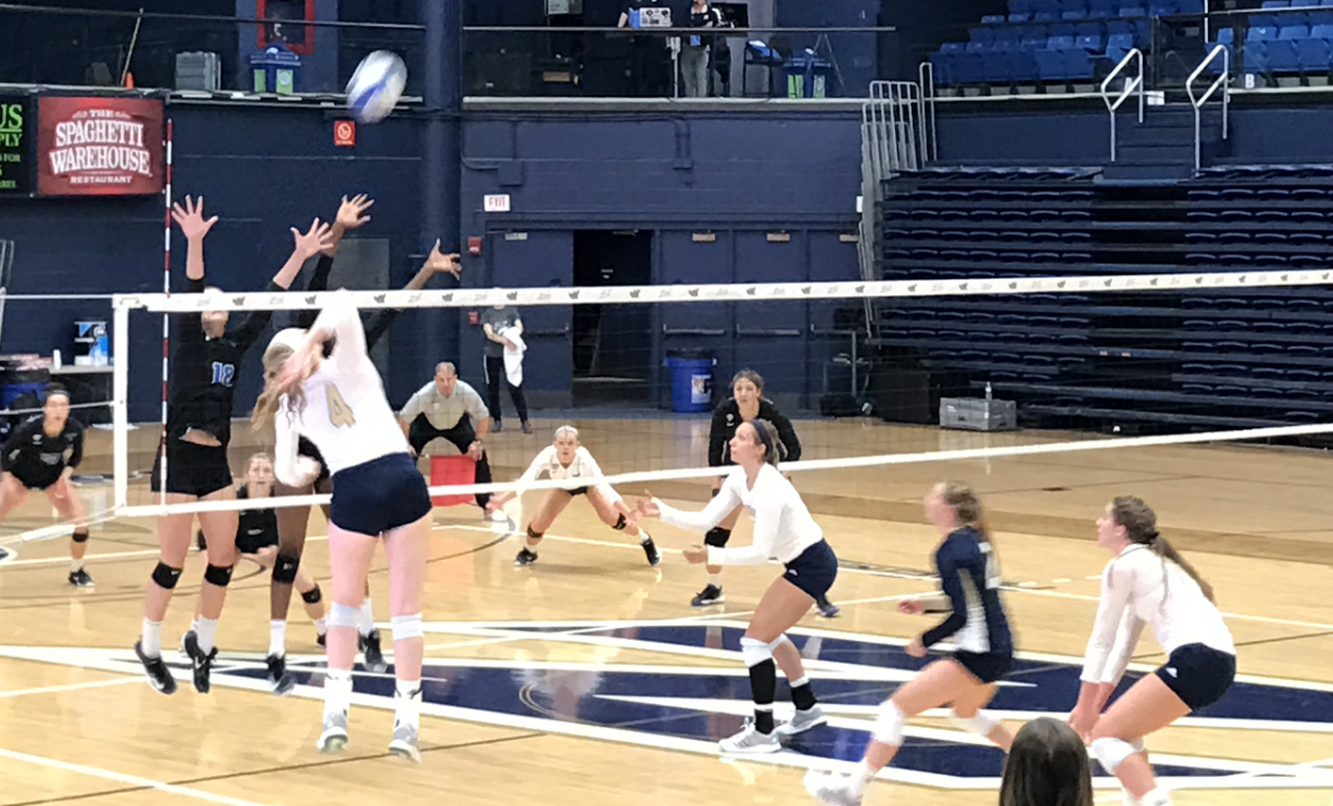 Outside hitter Elya Karsner attacks against Buffalo during Akron's match on Thursday, Nov. 2.