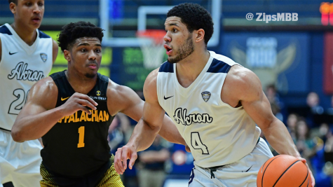 No. 4 Malcolm Duvivier dodges App State defense in Akron's win on Saturday. (Photo courtesy of Zips Men's Basketball)