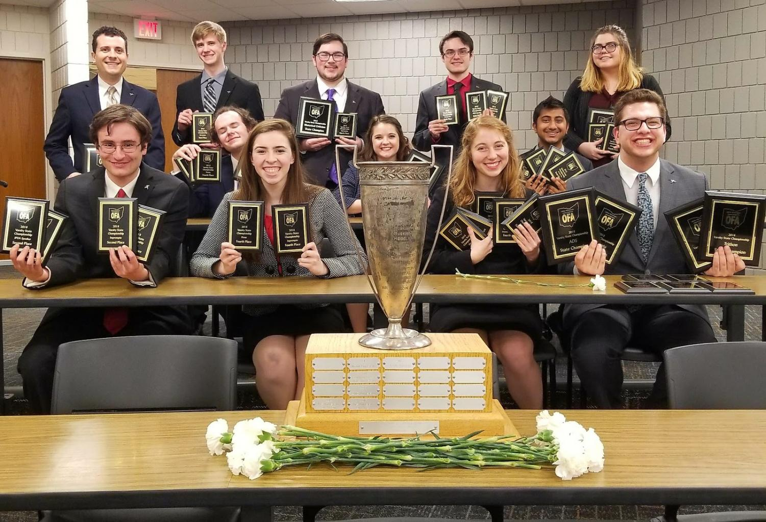 The Speech and Debate Team with their awards.