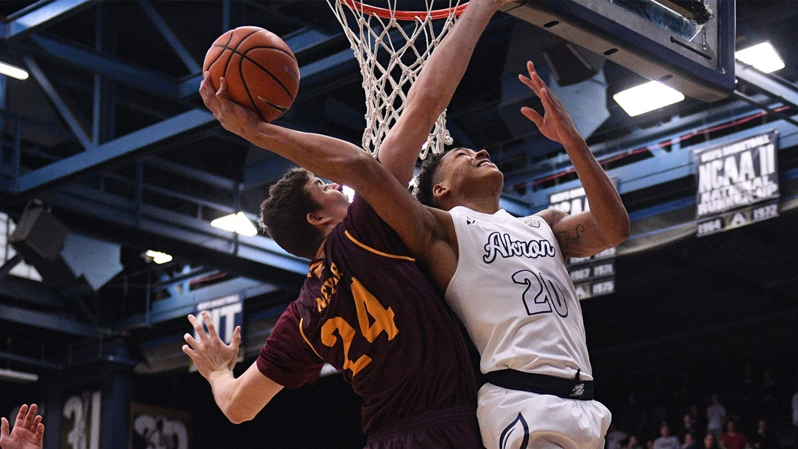 Zips Freshman guard, Eric Parrish 20 going up against the Chippewas. (Photo courtesy of Akron Men's Basketball)