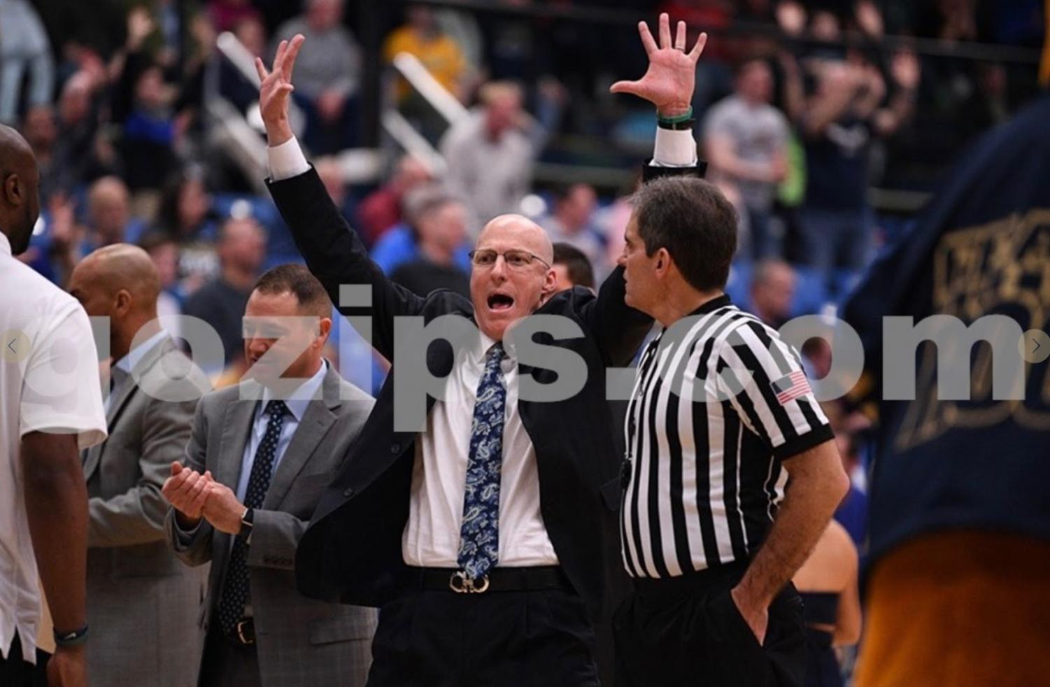 Coach Groce celebrating the Zips comeback during the first half. (Photo courtesy of Akron Athletics)