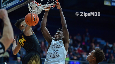 No. 22, Emmanuel Olojakpoke, slams home a dunk on Dec. 9 against Appalachian State, a little over a month before undergoing successful open-heart surgery. (Photo courtesy of Zips Men's Basketball)