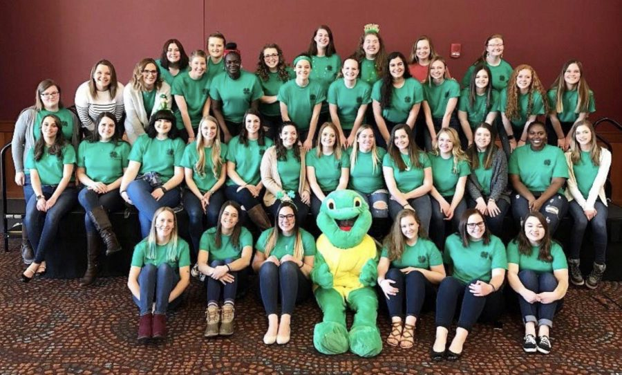 "Members of Delta Zeta's Akron chapter wear green to celebrate ""St. Paddy's Fest,"" a philanthropy event to benefit the Starkey Hearing Foundation. (Photo Courtesy of Delta Zeta)"