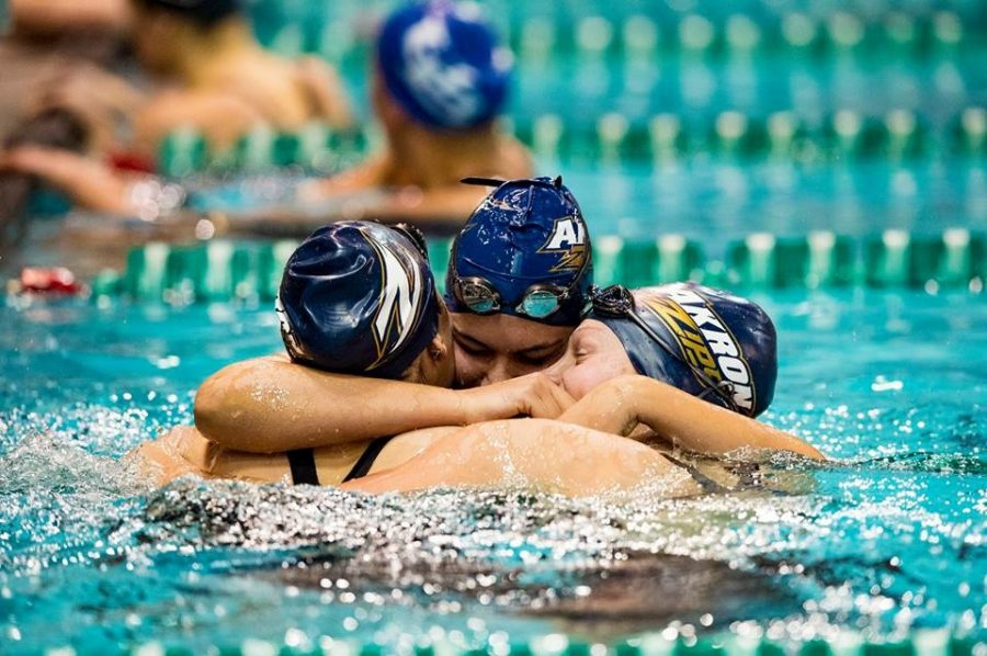 Zips+swim+team%2C+Ellie+Nebraska%2C+Paloma+Marrero%2C+Paulina+Nogaj+celebrate+the+teams+fifth-straight+MAC+Championship.+Photo+courtesy+of+Nestor+Vargas.+%28Photo+courtesy+of+The+University+of+Akron%29