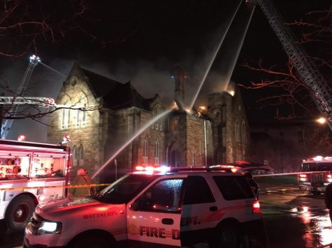 Flames shoot through the roof of the former UA Ballet Center.