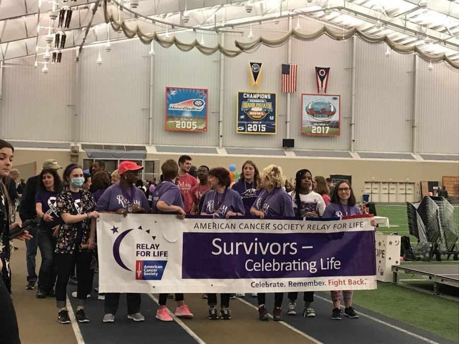 Survivors and Caregivers start the Survivor Lap. (Photo courtesy of Akron Relay for Life)