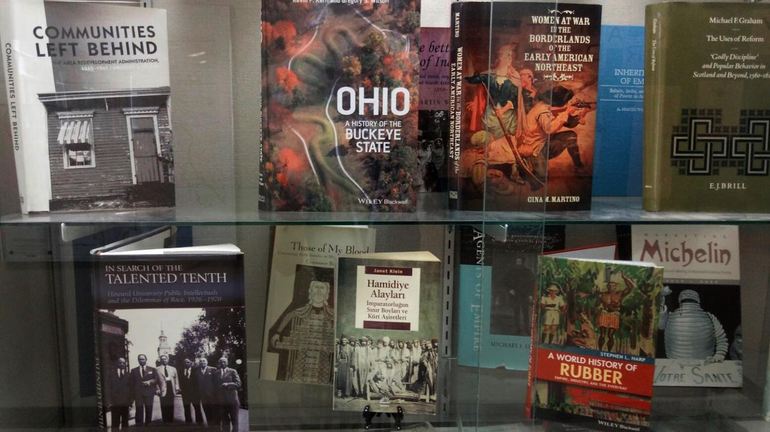 Various books written by UA History professors on display on the second floor of the Buchtel College of Arts and Sciences.