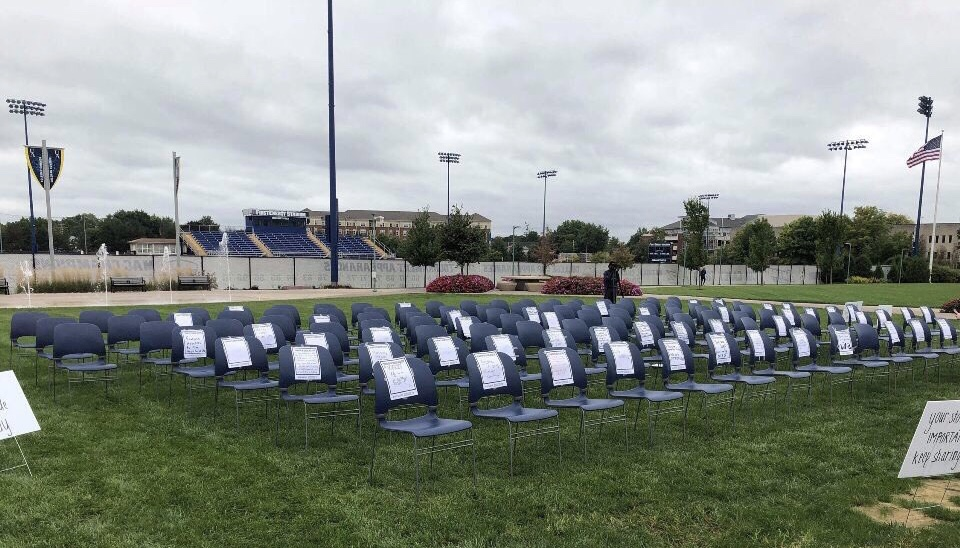 123 chairs sit on Coleman Common. Each empty chair represents a life lost to suicide each day. (Photo courtesy of Ruthie Hawks)