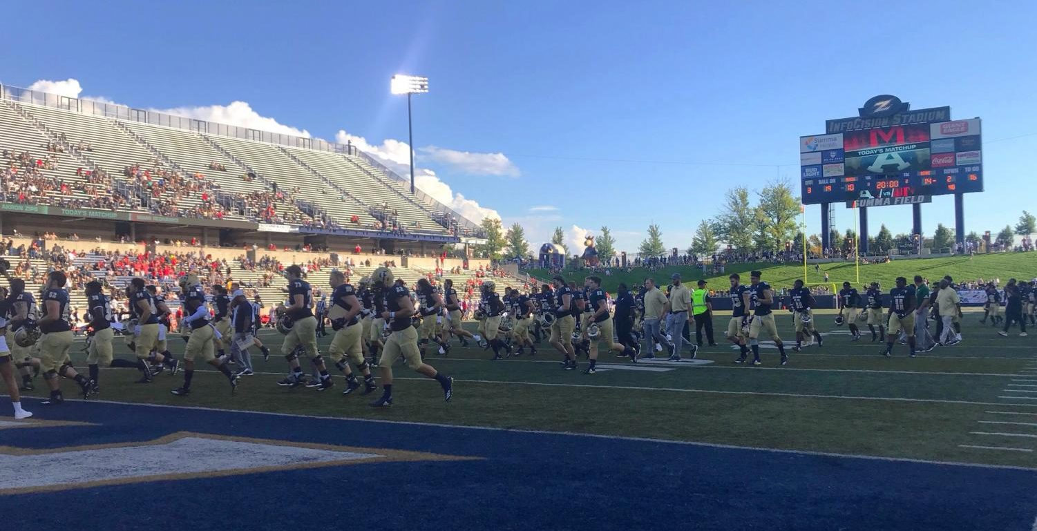 The Zips exit the field as the weekend's homecoming festivities take place during halftime.