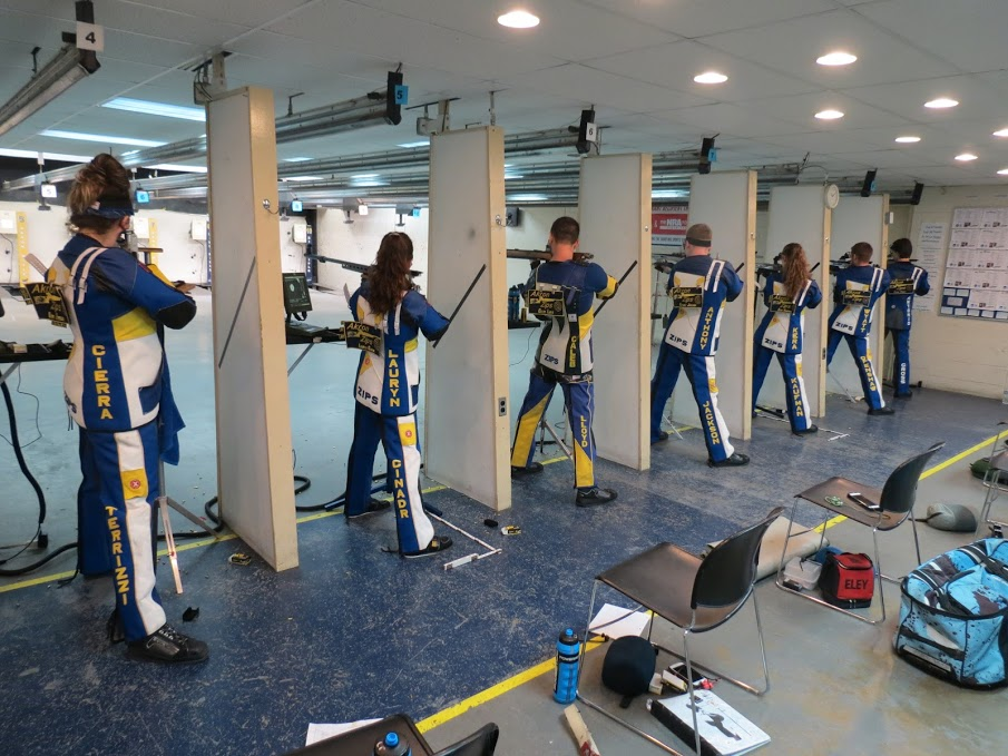 The Akron rifle team in action during the first weekend of the Zippy Open Rifle Tournament. (Image via Akron Zips)