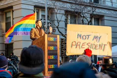 LGBT Solidarity Rally in front of the Stonewall Inn in solidarity with every immigrant, asylum seeker, refugee and every person impacted by Donald Trump's illegal, immoral, unconstitutional and un-American executive orders. (Image via Flickr)