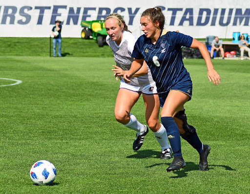 Akron Redshirt Freshman, Charley Kale (right) races to maintain possession of the ball from Marle Bringard (left), Central Michigan Junior.