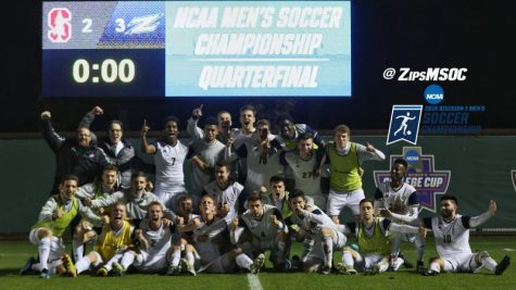 The Akron Zips Men's Soccer team celebrates their 3-2 victory over Stanford.