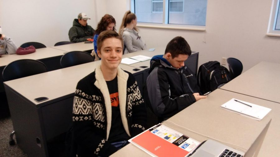Josh+Lloyd%2C+an+Akron+Early+College+High+School+student+sits+in+his+8%3A45+a.m.+Humanities+class.