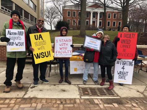 Faculty members from both UA and KSU standing in the picket line while holding signs of support for WSU faculty.