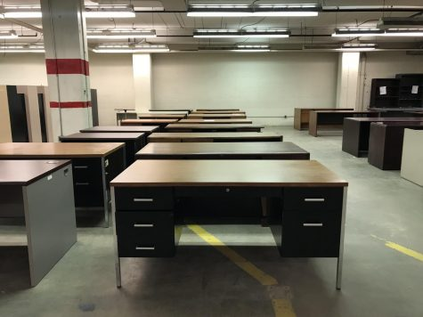 Gently used desks await their next owner in the warehouse of Central Stores.