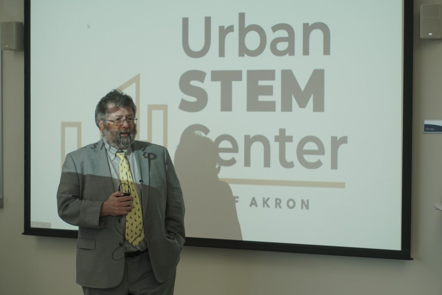 Interim President Dr. John Green welcomes guests at an open house for the Urban STEM Education Center on Tuesday.