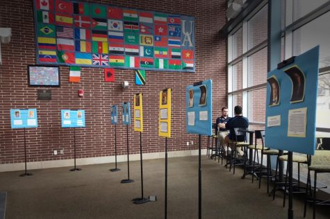 A display of all candidates for various positions in USG stands near the east entrance of Taber Student Union.