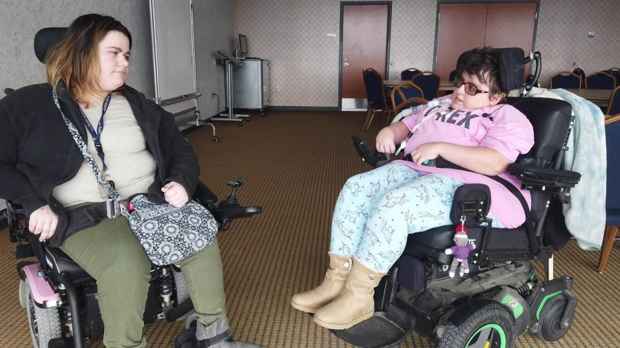 Hannah Laudo (left) tells copy editor Megan Parker (right) about her experiences with accessibility at The University of Akron.