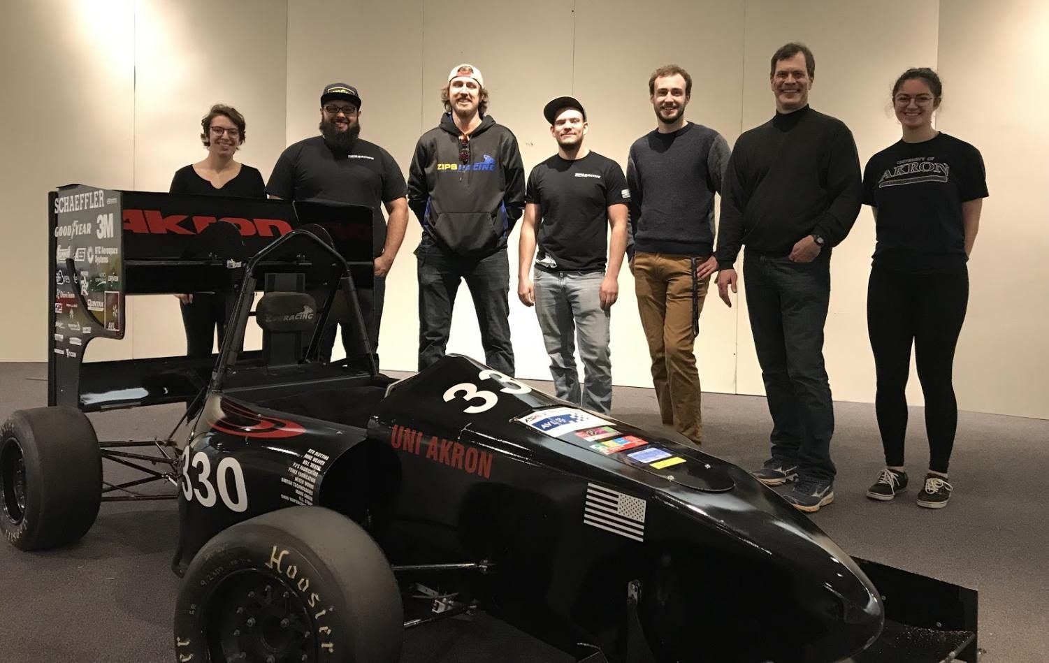Members of Zips Racing with the 2017 model race car that will be on display at the entrance of the Great Lakes Science Center's Vroom! A Car Adventure exhibit where visitors can get in the driver's seat for a photo. Team members are (from left)  Maria Hatzis, team captain Ezra Malernee, Jacob Greer, Clayton Brown, David McVan, faculty advisor Dr. Daniel Deckler, Ph.D. and Sidney Mingle.