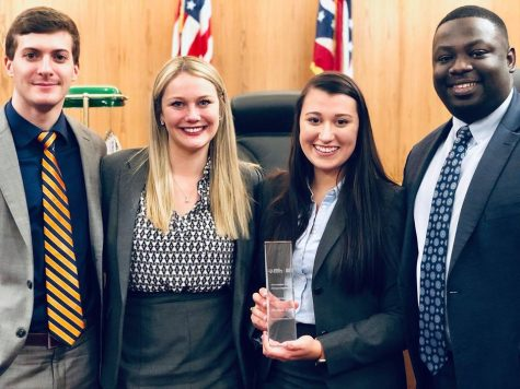 Akron Law's first-place trial advocacy team in March competition, from left: Justin Morgan (3L), Sarah Blank (3L), Cassandra Rosa (3L), Imokhai Okolo (2L).