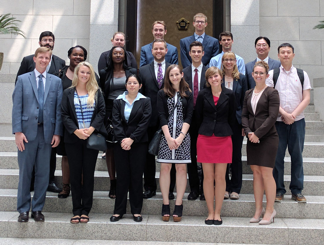 Former UA President Matthew Wilson (first row, far left) and former Vice Provost Sarah Cravens (second row, second from right) pose at the Supreme Court of Korea with UA and other law students in the two-country, three-city, four-week study abroad program.