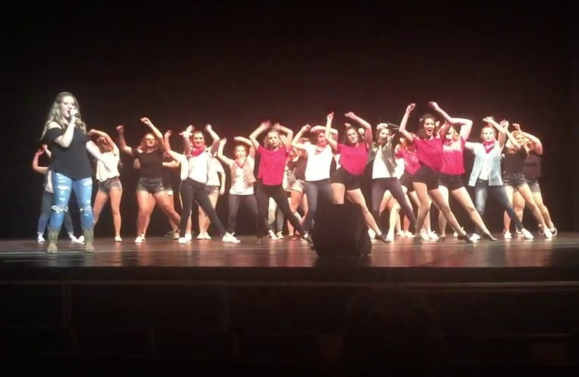 The+ladies+of+Alpha+Gamma+Delta+perform+%22Footloose%22+on+stage+during+Songfest+2017.