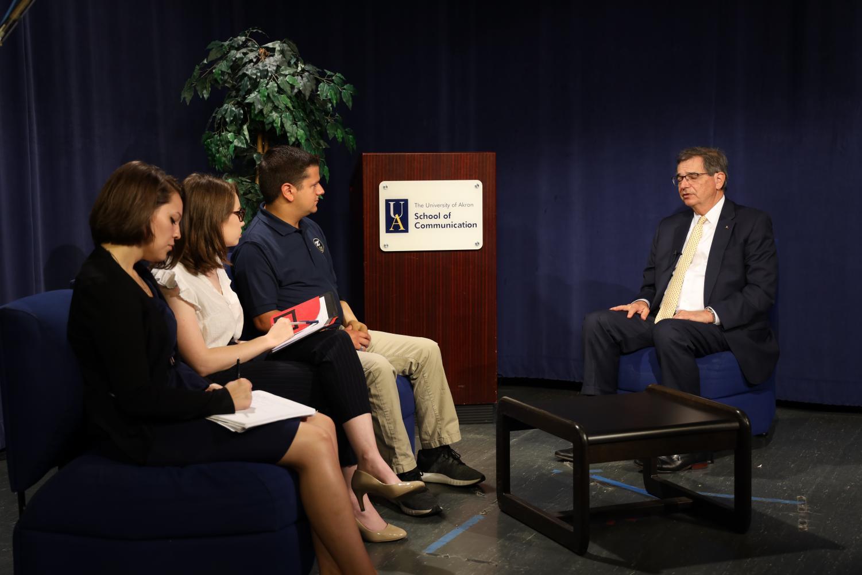 President Gary L. Miller speaks with student media representatives from The Buchtelite, ZTV and WZIP.