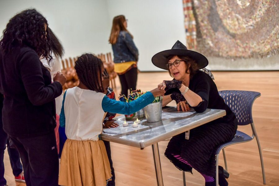 Families and children participating in hands-on activities during a previous the Trick or Treat event at the Akron Art Museum.