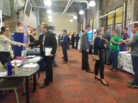 "Students meeting with companies after the ""speed dating round"" to network with professionals."