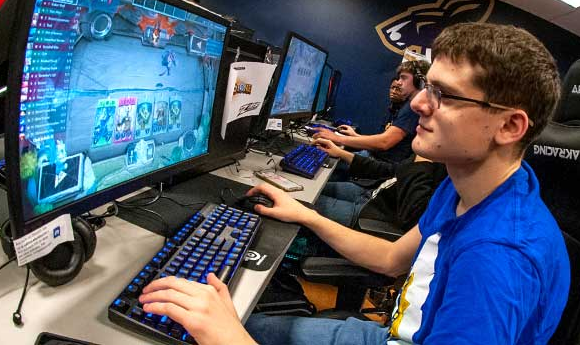 Students from The University of Akron playing on one of Esports' several locations on campus.