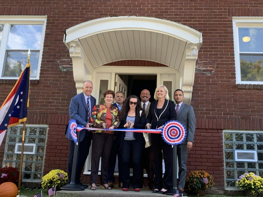 Several officials from Summit County and nonprofit organizations cut the ribbon, marking the opening of the Summit Liberty House.
