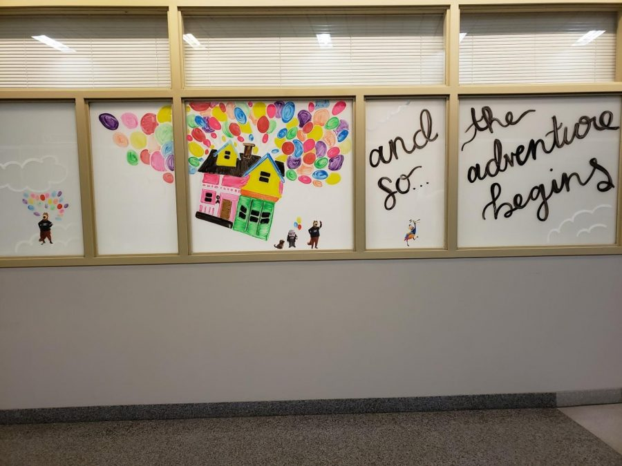 "The Office of Accessibility's window decorated with Zippy and characters from the movie ""Up"" to inspire students on campus."
