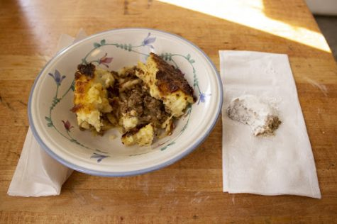 A bowl of Pastitsio and a Greek Almond Wedding Cookie from Western Fruit Basket.