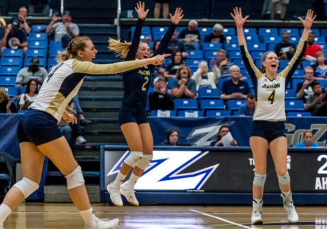 The Akron Women's Volleyball team celebrates after playing against Ball State, winning three to two.