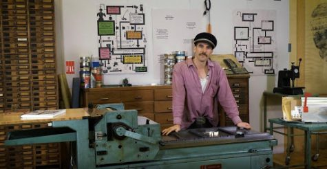 Dafi Kühne poses next to one version of a letterpress.