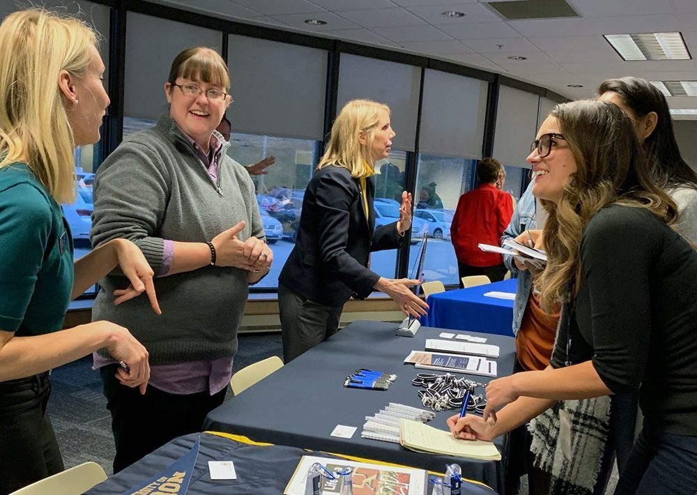 UA representatives speak with interested FirstEnergy employees at an open house for 'Educate to Elevate' on Oct. 29