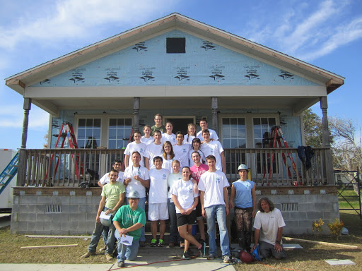 Students involved with Campus Habitat for Humanity pose after participating in winter build trip.